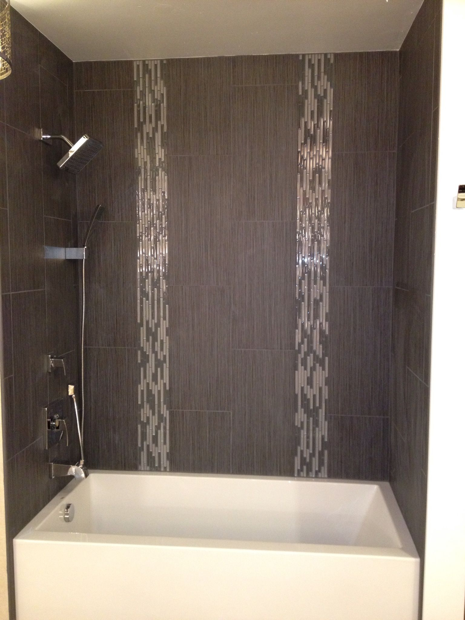 We love emser tile look how amazing our display is let for Tile shower surround