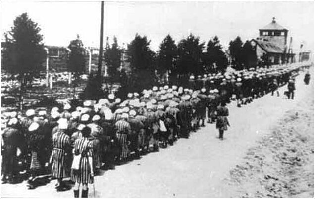 Prisoners being returned to the Ravensbruck Women's Concentration Camp after a day of forced labor.