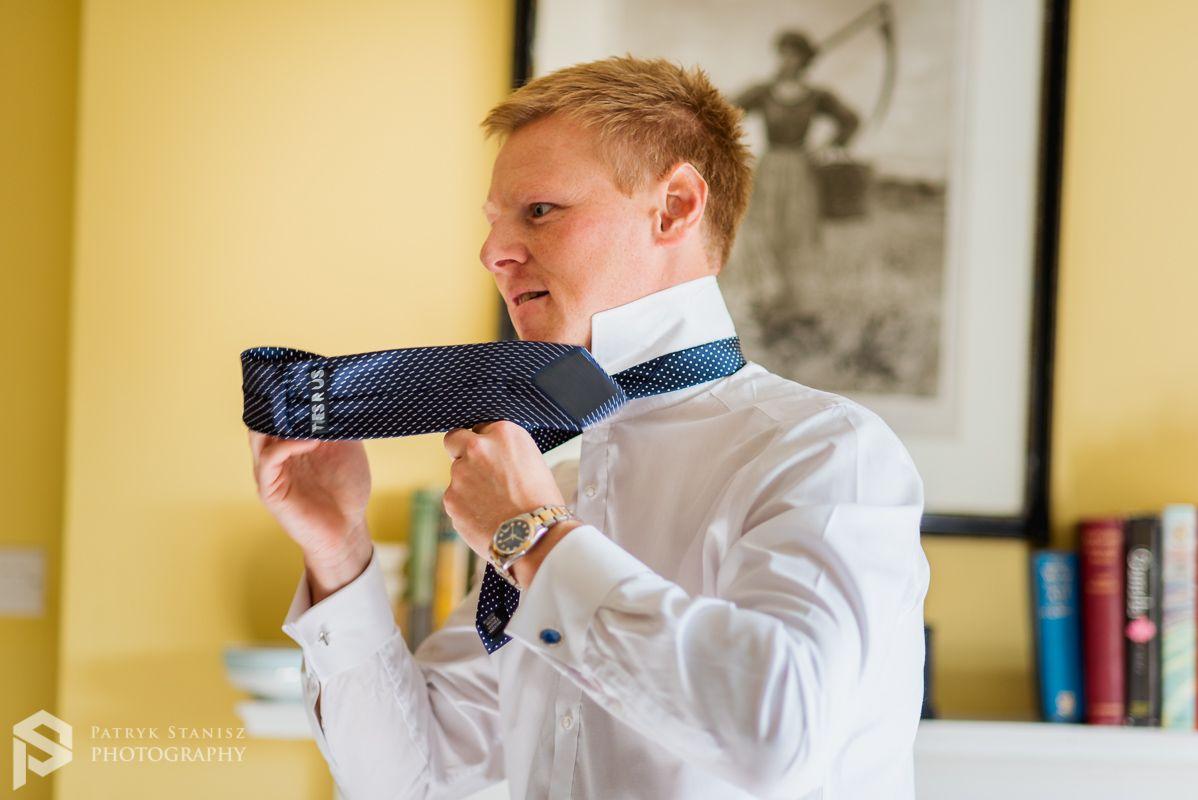 Groom Is Tie A Tie Wedding Court Beautiful Wedding Venues Wedding Photographers
