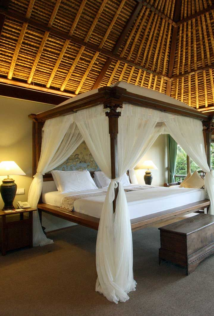 Each of the standalone villas feature traditional thatched ...