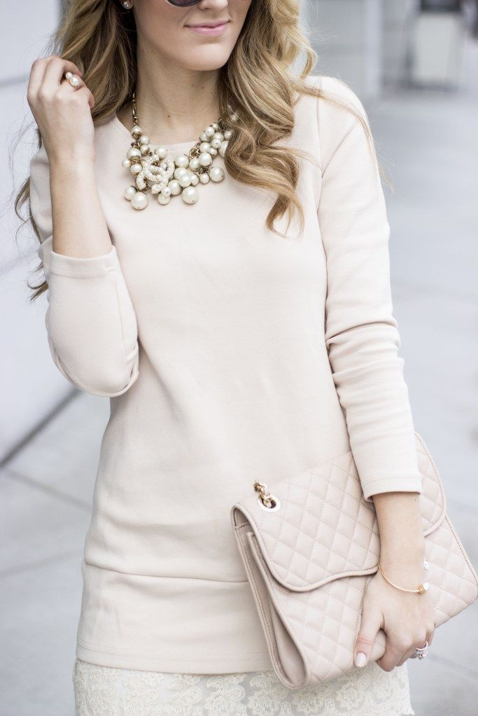 2637b310572afa Pearl necklace with a Chanel brooch pinned on it