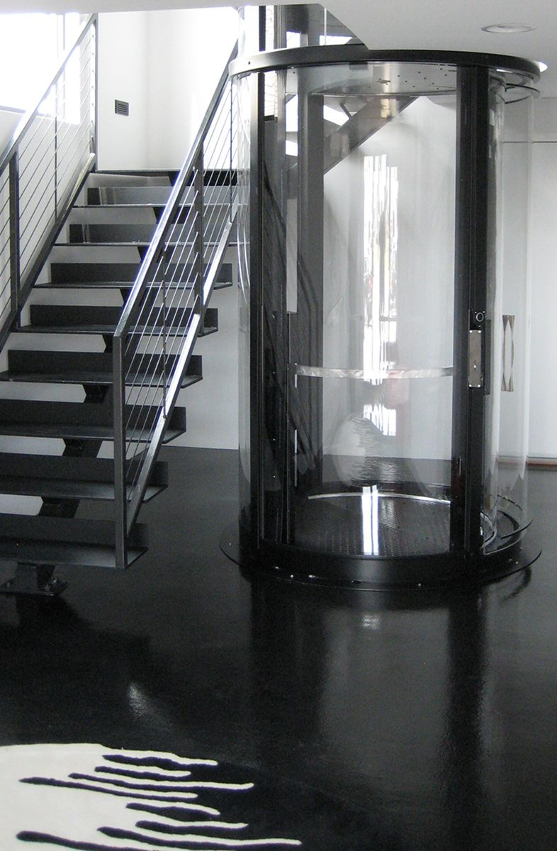 Visilift round glass elevator a beautiful addition to a for Modern home elevators