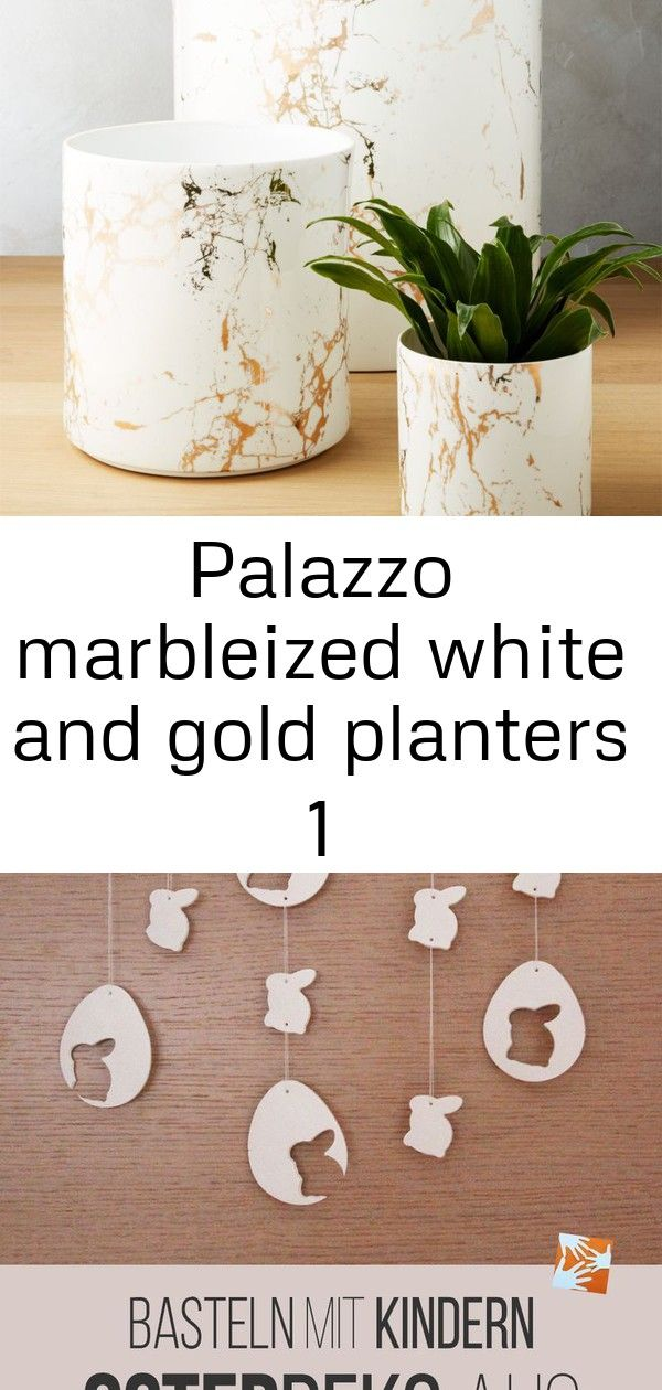 Palazzo marbleized white and gold planters 1 Shop Palazzo Marbleized White and Gold Planters Thin ceramic cylinders mimic marble with a metallic twist Gold metallic decal...