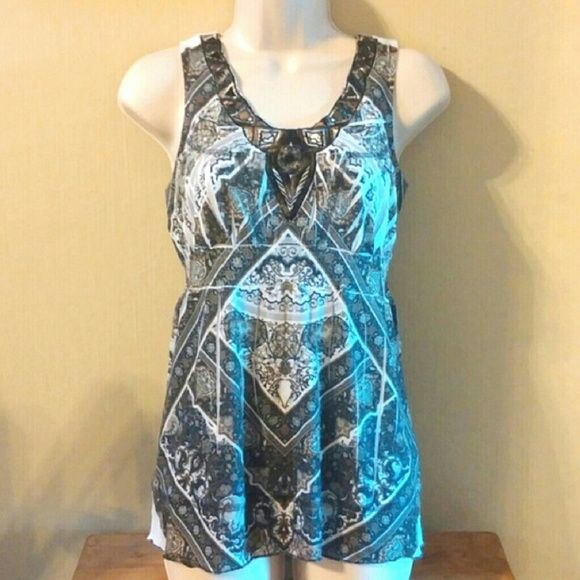 One world top Very cute design and colors.  This top is very flattering. ONE WORLD Tops