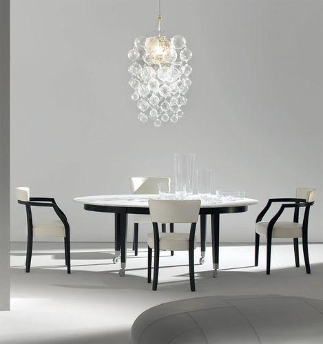 Tavolo moderno / di Philippe Starck / con rotelle / ovale ...