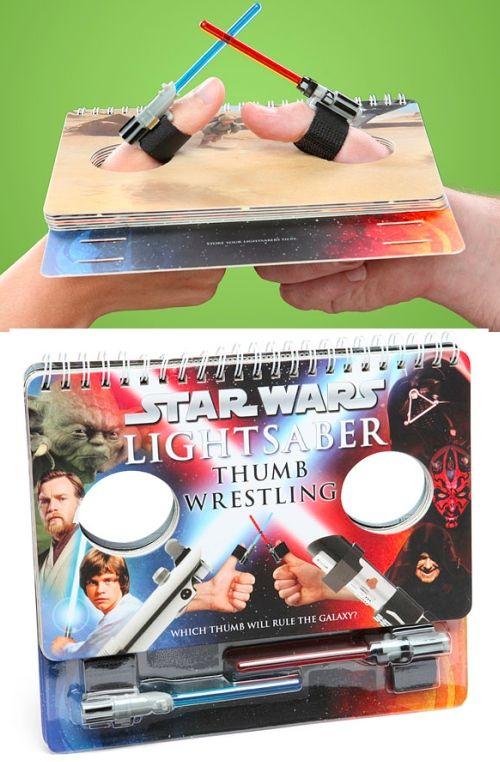 The Star Wars Lightsaber Thumb Wrestling game book provides multiple arenas  for epic lightsaber thumb duels. GetdatGadget.com
