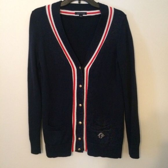 NWOT Tommy Hilfiger Navy Cardigan Sweater Brand New, never worn sweater by Tommy Hilfiger. Navy, with a red and white stripe detail. Gold buttons accent the cardigan, and add a nautical feel. If you have any questions feel free to comment below, and all reasonable offers are considered! Happy Poshing! Tommy Hilfiger Sweaters Cardigans