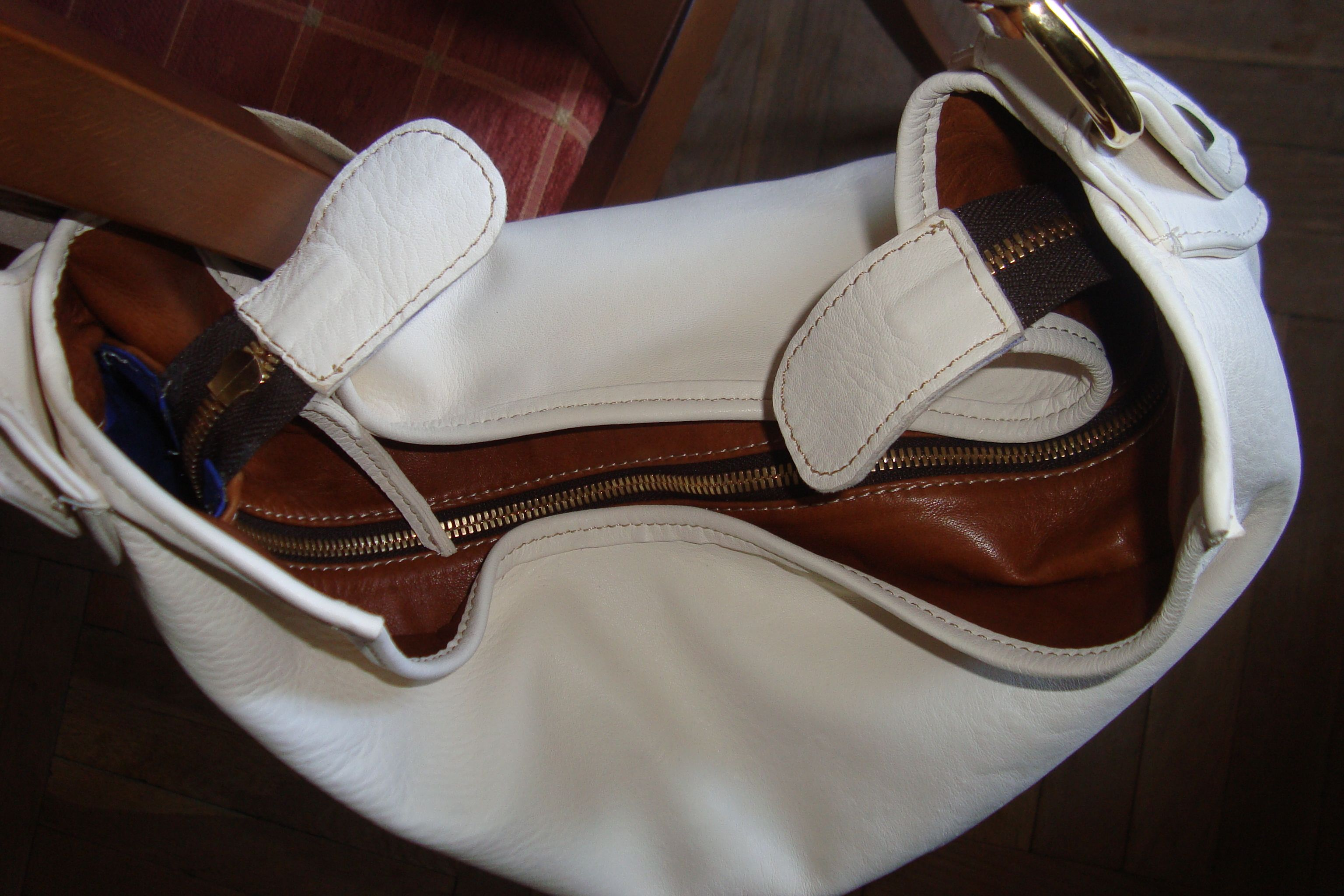 """detail of """"why are they still after me"""" the zipper is like butter, and the leather is incredibly soft, and it's very roomy and easy to use!  i just finished it, so i really love it!"""