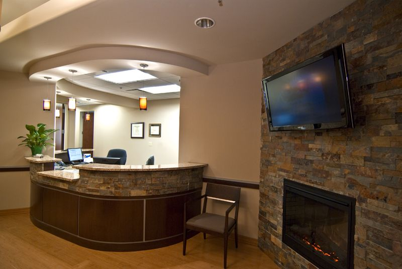 office reception decor. Make Your Office Feel Welcoming With Warm Colors And A Fireplace. (Via Www. Reception Decor