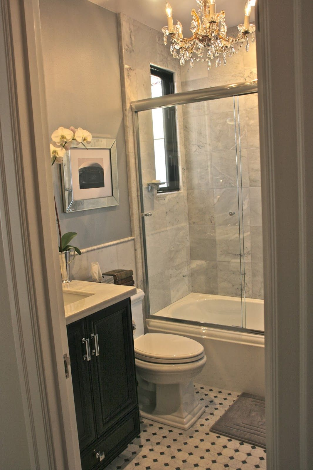 a night at the boxwood house. guest bath with window in shower