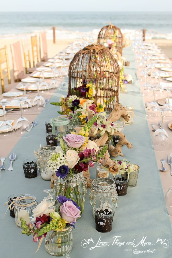 Perfect wedding decor at the Barcelo with the Sea of Cortez! as a background! Oustanding bird cages floral design by www.cabofloralstudio.com!