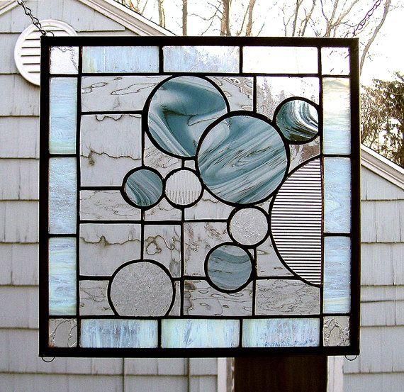 Nueve círculos con azul hielo dentro de un por StainedGlassArtist