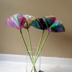 These easy watercolor flowers are made from coffee filters and are a cheery way to spruce up any space!