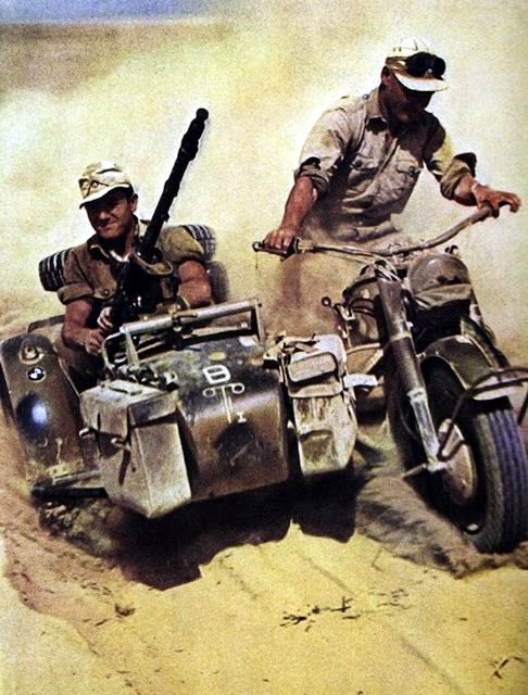 BMW R 75 of DAK (Deutsches Afrikakorps) in the North African desert. Motorcycle showing symbols for 1.(leichte)Batterie / I.Abteilung / Artillerie-Regiment 155 / 21.Panzer-Division (also symbol on sidecar mudguard is for motorized infantry). Motorcycles equipped with sidecar and machine gun just like in this picture were widely used by the german messengers along the various war fronts.