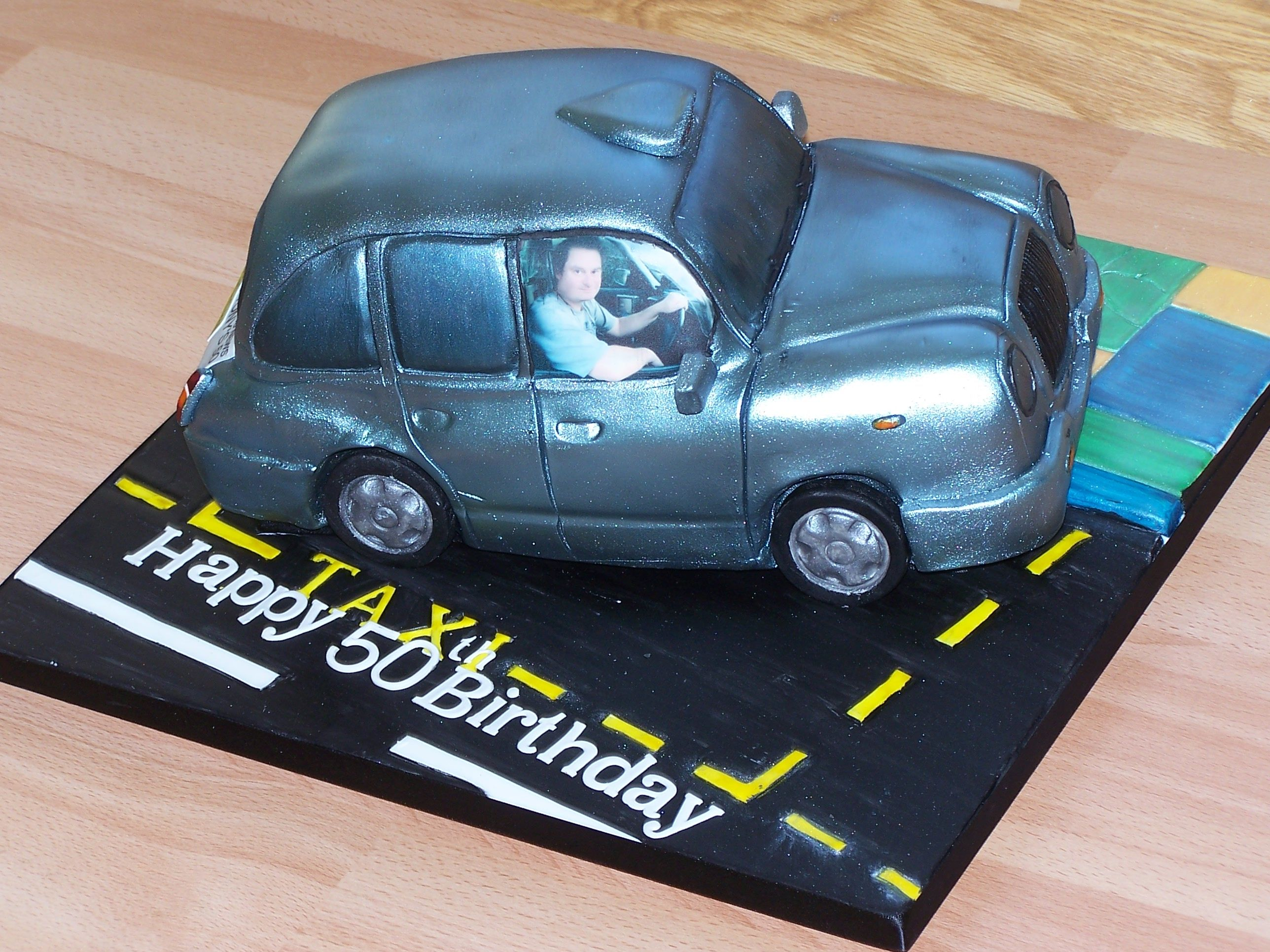 A novelty cake by cks cakes ltd for a 50th birthday Modeled from a