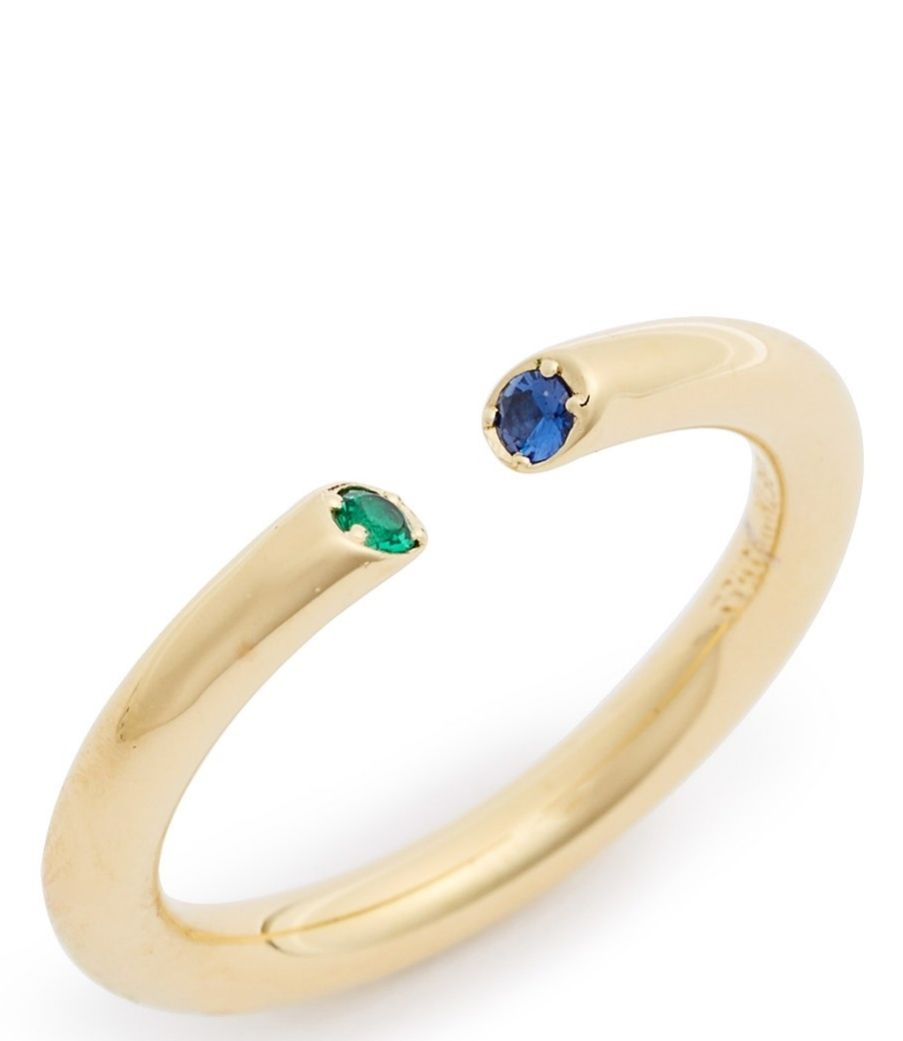 The simple design of this 23karat gold ring featuring sparkling