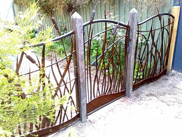 Reeds, bullrush and flowing water. Forged garden gate and fence ...