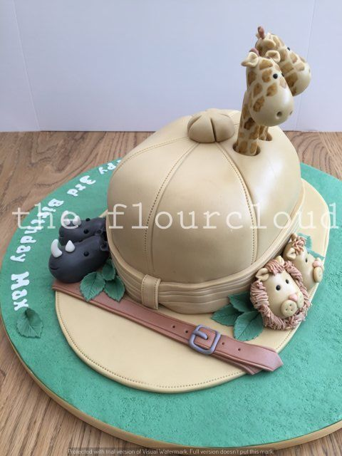 A gorgeous Safari hat and animals birthday cake joint bday safari