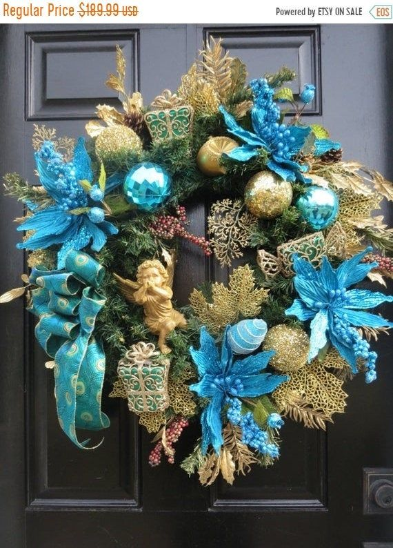 Photo of Angel Christmas wreath for front door, Victorian Christmas door wreath, Christmas wreaths, peacock blue poinsettias, antique gold cherub
