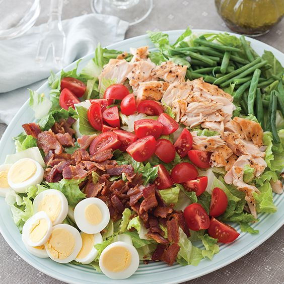 This hearty Salmon Cobb Salad has the traditional crispy bacon, tomatoes, and egg we all enjoy. Substitute the salmon for your grilled chicken,  pork, beef, or turkey for even more variety.