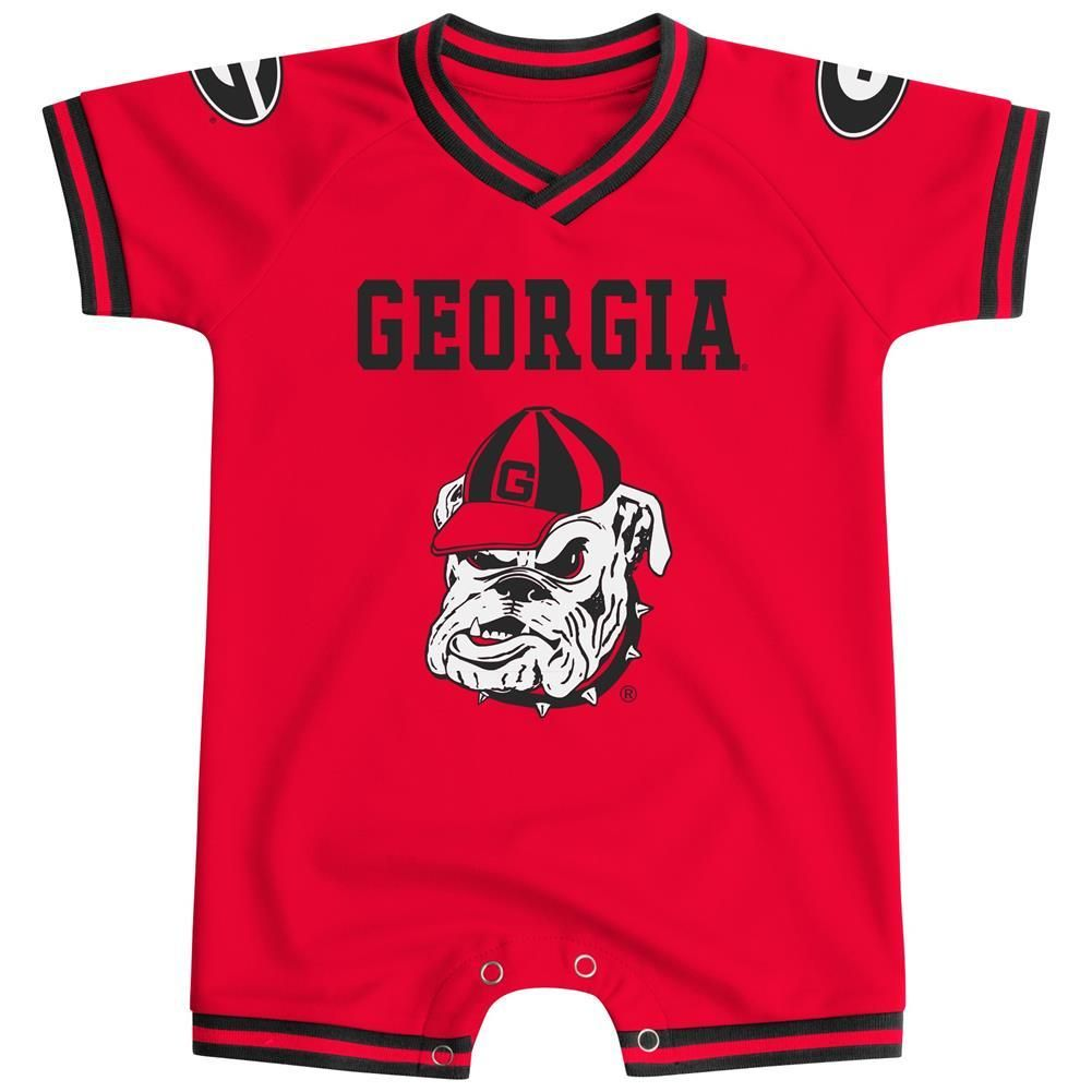 Georgia Bulldogs Infant Football Jersey Logo Romper. This super cute jersey like baby outfit is made of 100% Cotton with secondary color trim around neck, sleeves and the leg cuffs. The romper features the Bulldogs logo and team name boldly printed across the front. The Bulldogs logos are also on each shoulder. Bottom snaps for diaper access and to make it easy to dress your littlest Bulldogs fan for the big game! Go Dawgs!!