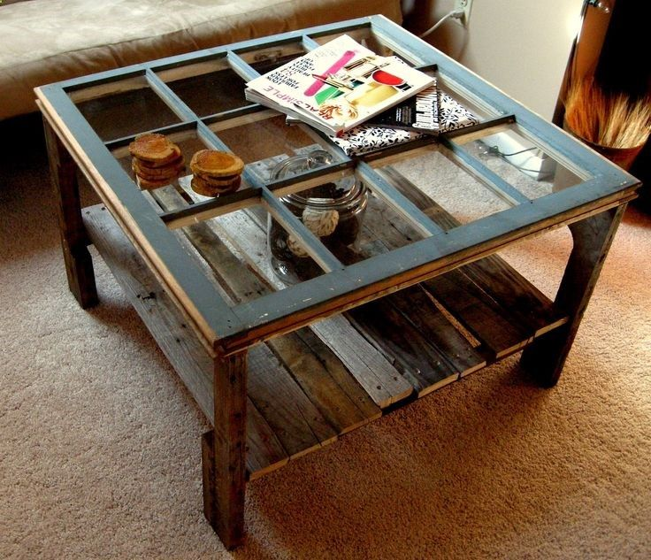 Old window  pallet coffee table...wed probably put a thick piece of glass over the whole thing for easy cleaning and to make an even tabletop, but what a fun idea!
