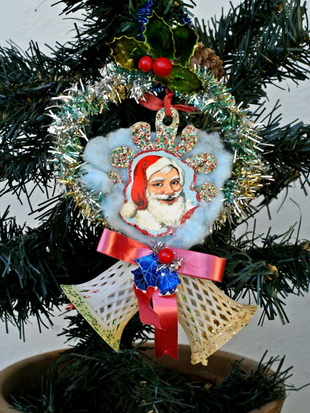 Antique christmas bell ornament decorated with an