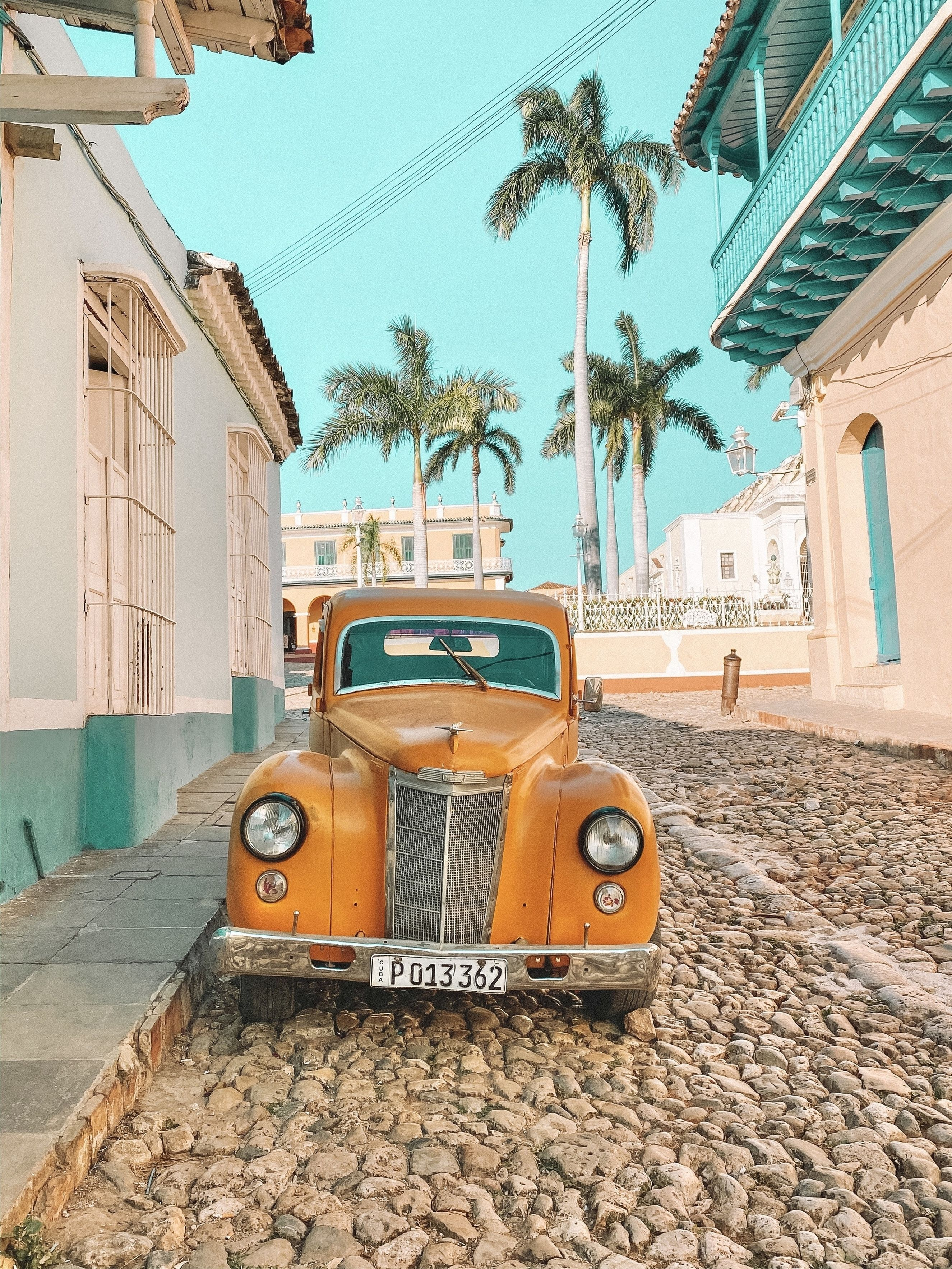 sHow amazing is Cuba?! Look how beautiful Trinidad is! There are so many amazing photo opportunities, it's hard to narrow everything down. It's super easy to get around Cuba - whether you are traveling on your own, with a friend or with a group. For anyone researching, I found the easiest way to get around the country was in shared taxis!   #cuba #trinidad #travelcuba #explorecuba #caribbean #solofemaletravel #cubatravel #cubacars #cubancars #havana #backpacking #caribbeantravel
