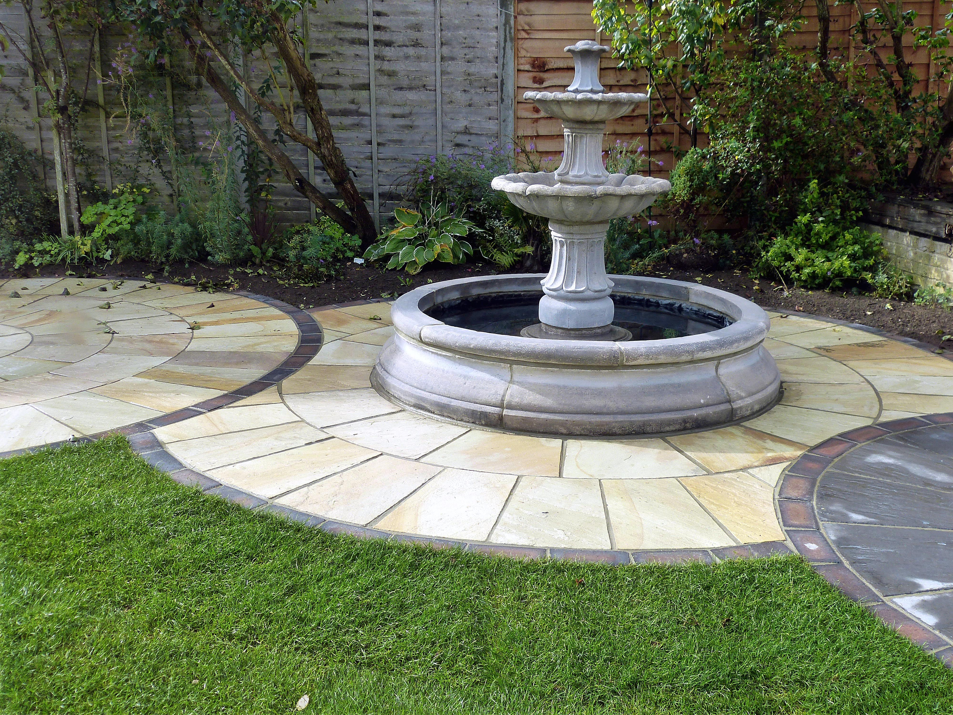 Water Fountain on Stone Circle Garden Design by Hambrooks