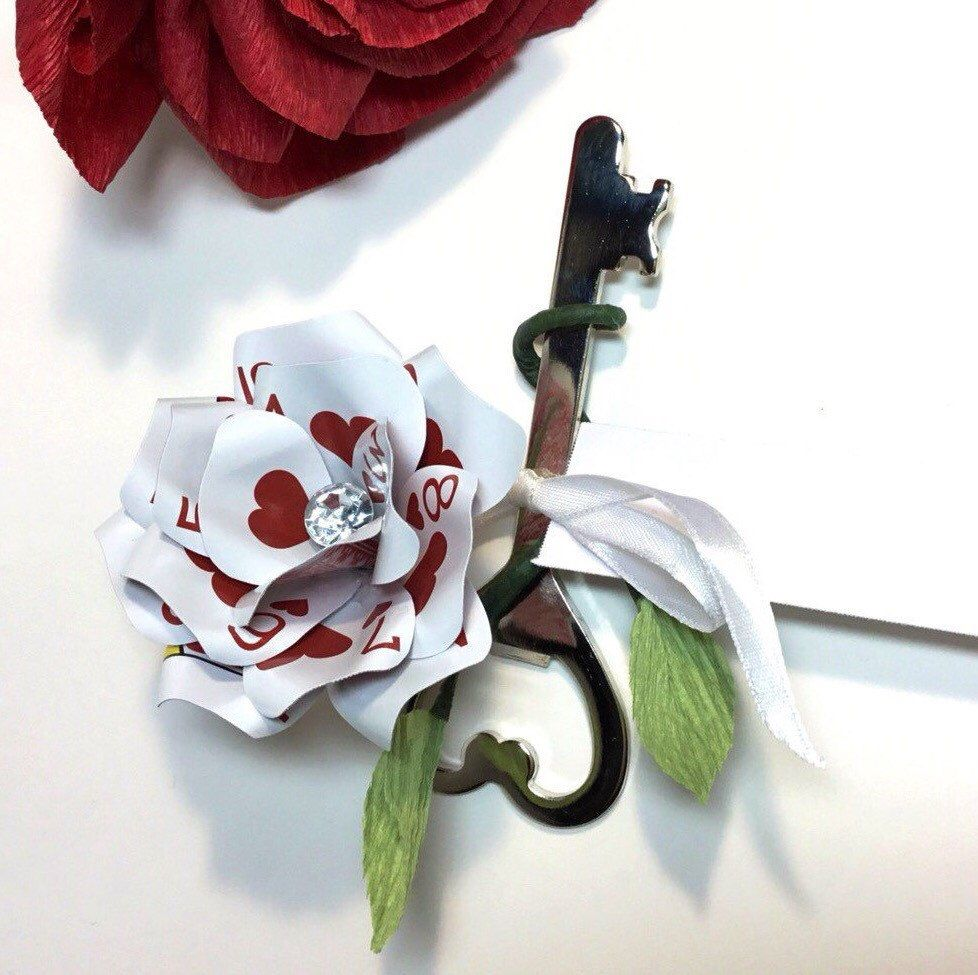 Playing Card Flower with Heart Shaped Key Bottle Opener, Poker Gift, Casino Party, Vegas Wedding Favors, Poker Decor, Playing Card Flowers by ThePaintedPetaler on Etsy https://www.etsy.com/listing/271135455/playing-card-flower-with-heart-shaped