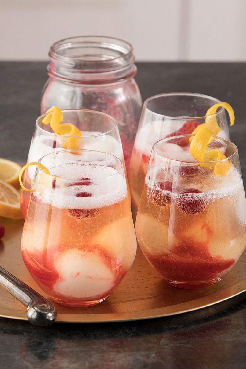 A delicious homemade raspberry-infused syrup goes into these beautiful champagne and fruit cocktails. For the