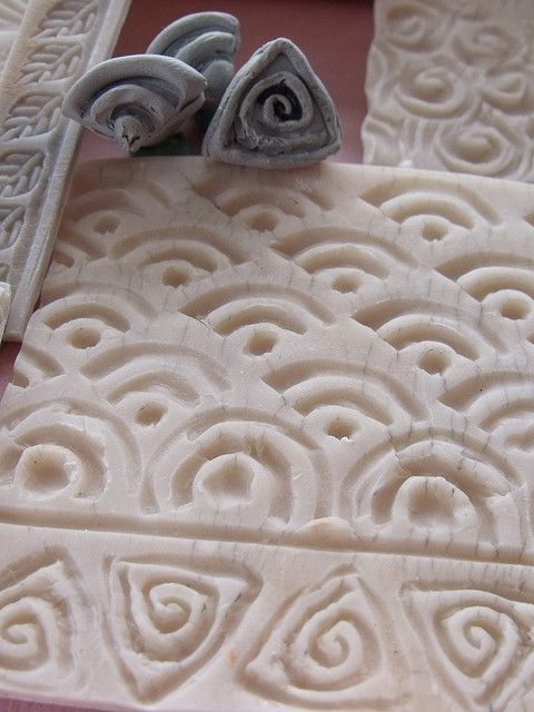 Detail - The small sculpted stamps made with extruded clay attached to the ends of snakes were used to make the larger stamp below.   by Jill Palumbo, via Flickr