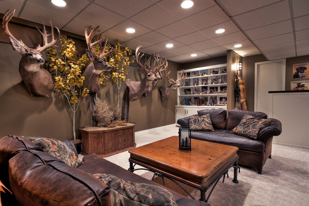 Upscale Outdoorsman Man Cave with tray ceiling, stacked-stone ...
