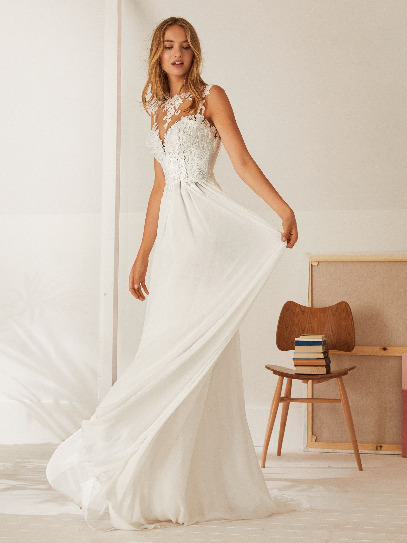 d58f3230dd6 Osaka by Pronovias White One gown bring something new and super cool to the  wedding day