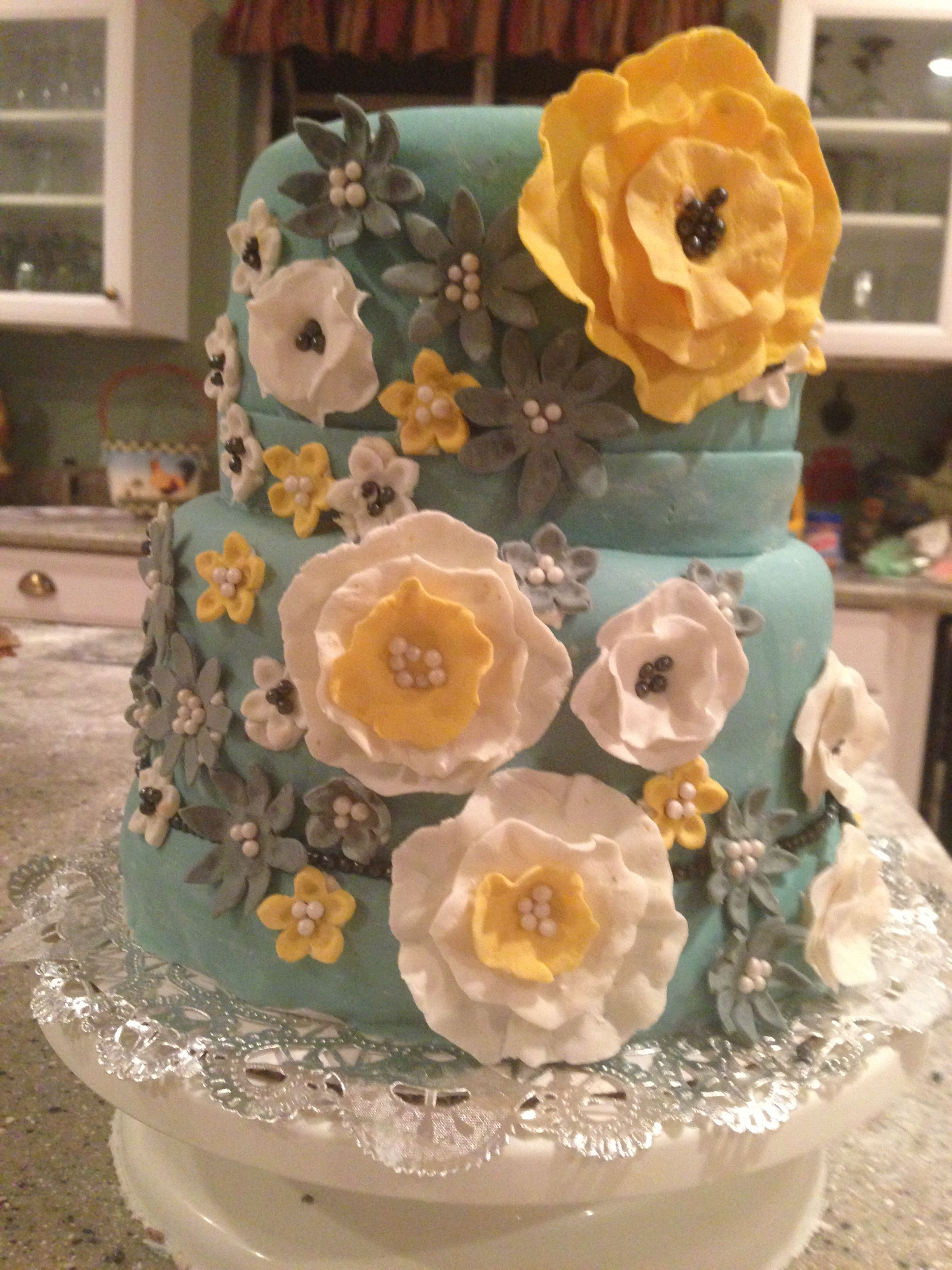 Teal and yellow wedding cake like the idea but a little less going on