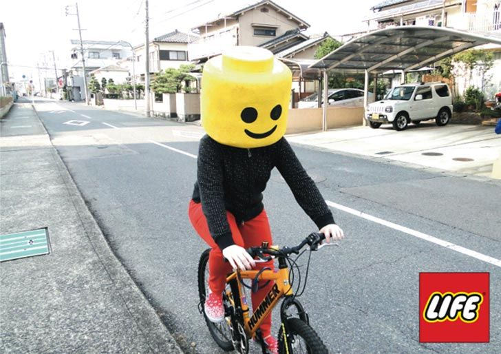 This is a #photograph of a real life #Lego man riding a