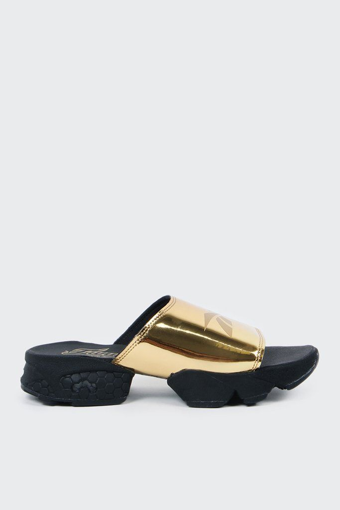 5516e40f67b2 Reebok Womens Fury Slide Magic Hour - gold metFit  True to sizeMaterials   Synthetic upper