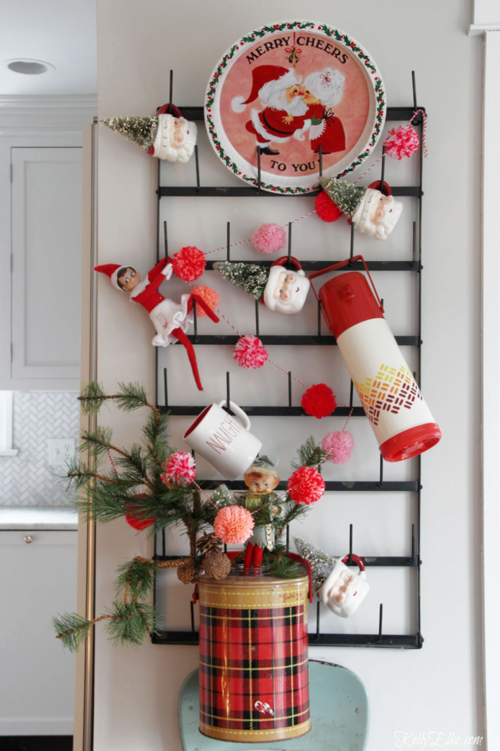 Creative Ways to Display, Craft and Store Bottle Brush Trees #mugdisplay Vintage Christmas display - love the Santa mugs and old thermoses kellyelko.com #vintage #vintagedecor #vintagechristmas #santa #christmasdecor #christmaskitchen #kellyelko #mugdisplay