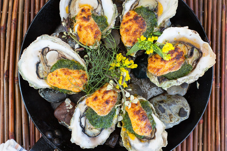 The Schooner Restaurant Netarts Bay Or Oysters Rockoyaki Netarts Bay Oysters Wood Oven Roasted With Pork Belly Greens Garl Oregon Coast Oregon Food Lover