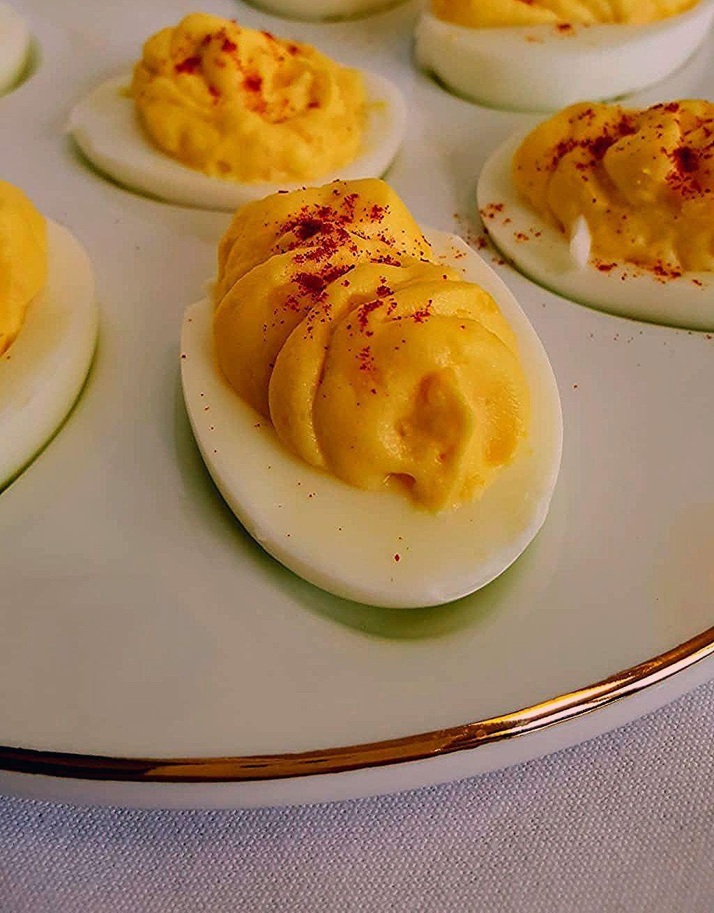 Classic Deviled Egg Recipe using mayonnaise, mustard, sugar, vinegar, and salt. Including a foolproof way to fill your deviled eggs and how to video. #deviledeggs