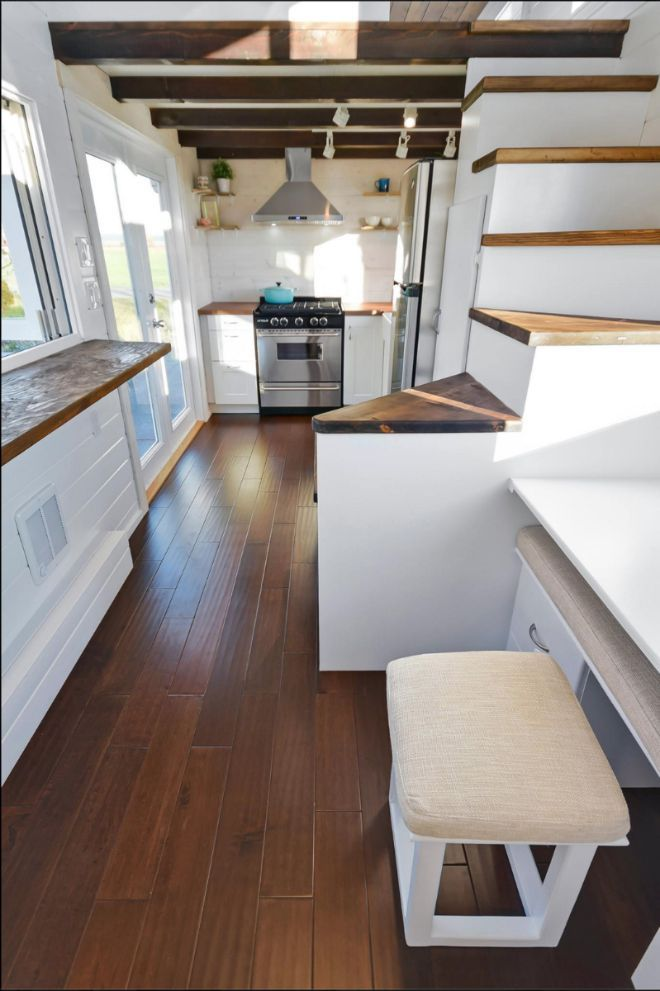 Sweet little desk nook in this well-lit white tiny house.   Oversize bathroom and kitchen take center stage in this tiny home   Tiny Homes