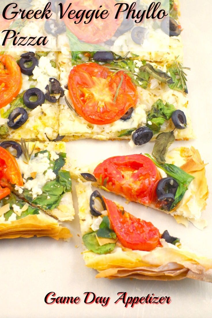 This Vegetarian Greekstyle phyllo pizza with feta basil and tomatoes is healthier than your typical game day food but youd never know it The butter and cheeses between th...