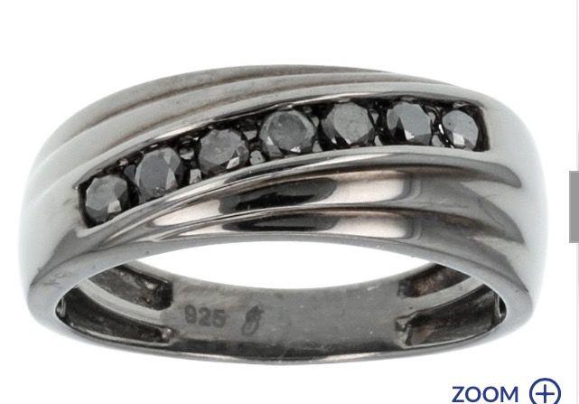 Black diamond ring Adrian wants this