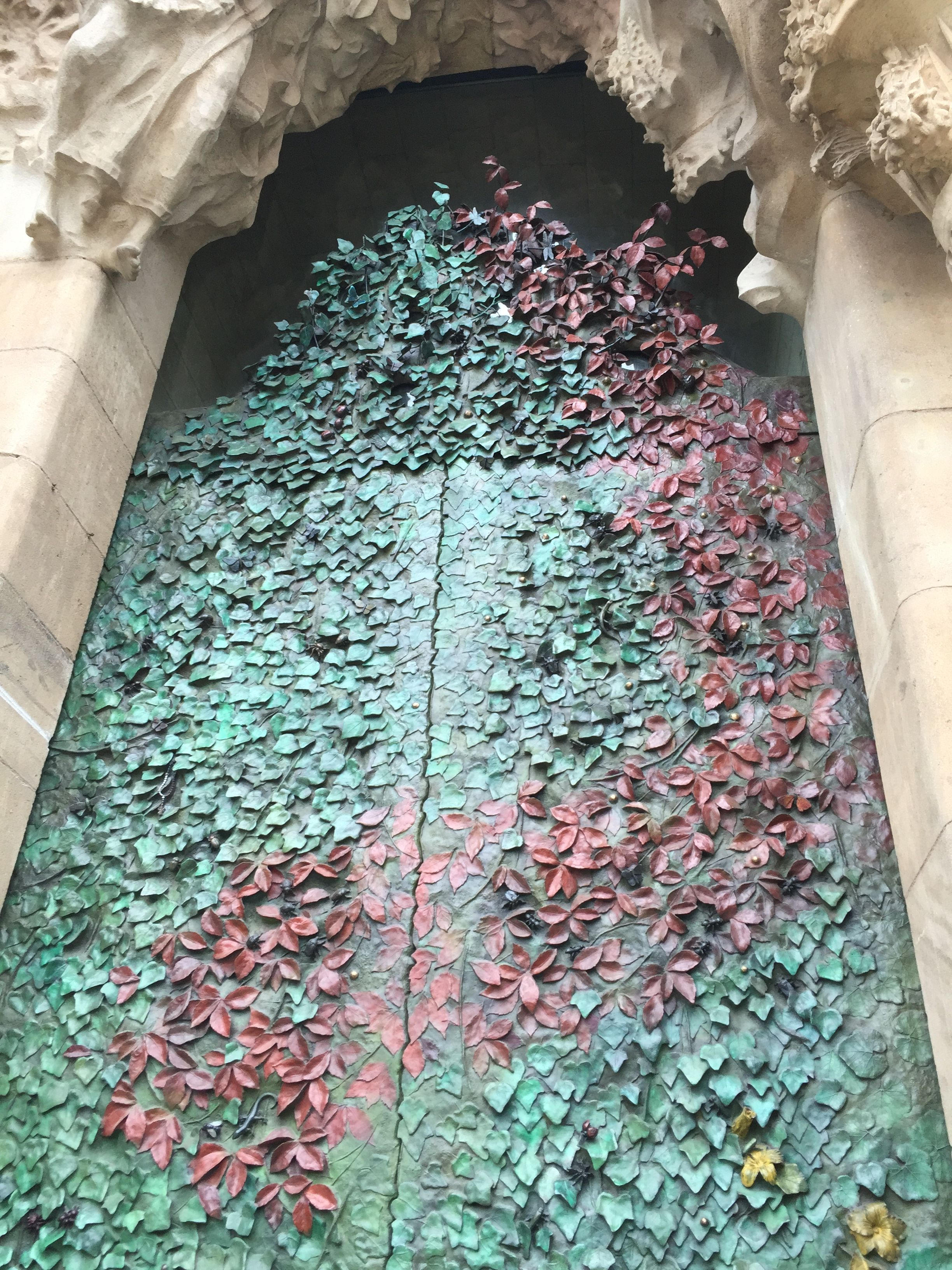 The leaf-covered doors of the Nativity Facade in Gaudi's ...