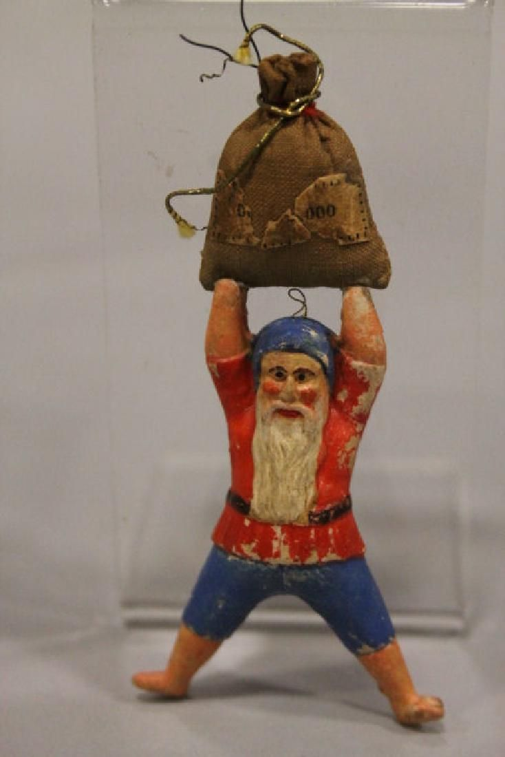 Lot: Christmas Ornament - Dresden Dwarf w/ Money Bag, Lot Number: 0551, Starting Bid: $50, Auctioneer: Stony Ridge Auction, Auction: Day 1 Christmas Ornaments & Fiesta Ware, Date: January 21st, 2017 CST