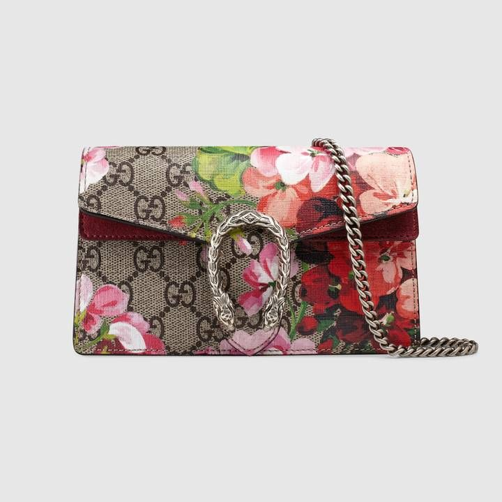 3907ab9a67a33e Shop the Dionysus GG Blooms super mini bag by Gucci. A structured Blooms GG  Supreme canvas chain super mini bag with a key ring that can be used to  attach ...