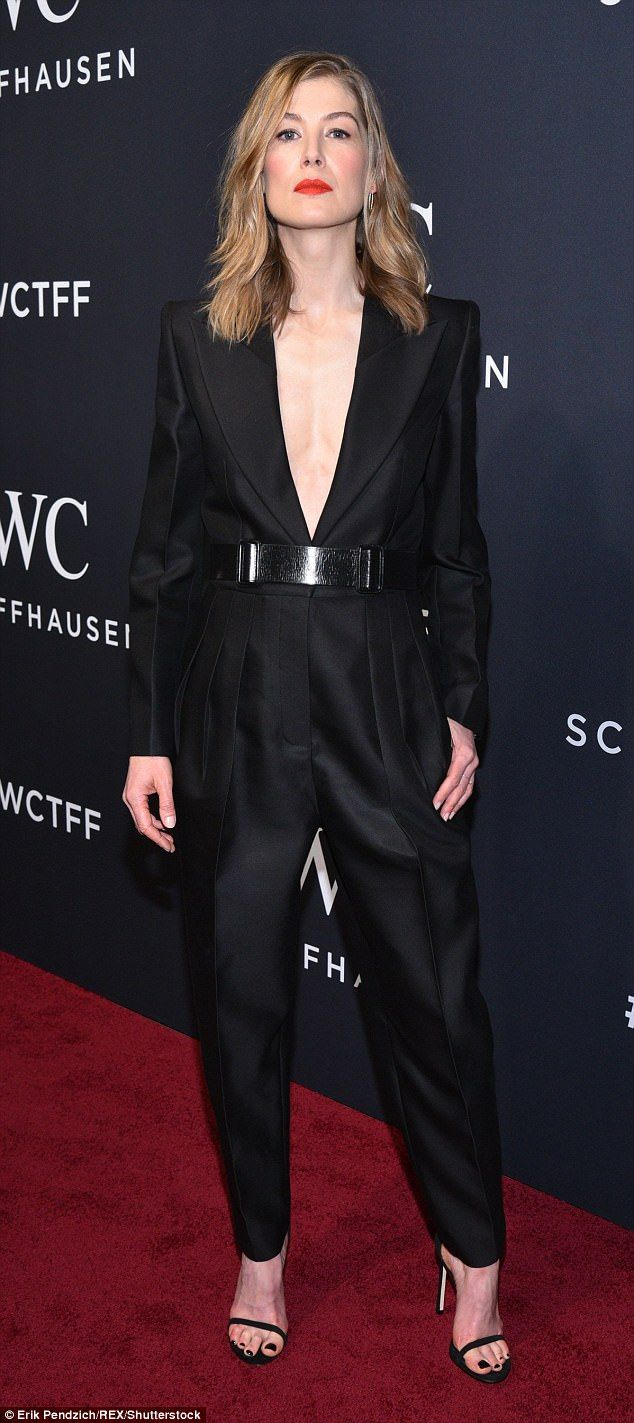 4e4d0468cc Stunner  English actress Rosamund Pike chose a tailored black jumpsuit with  a jacket-style bodice slashed to the waist