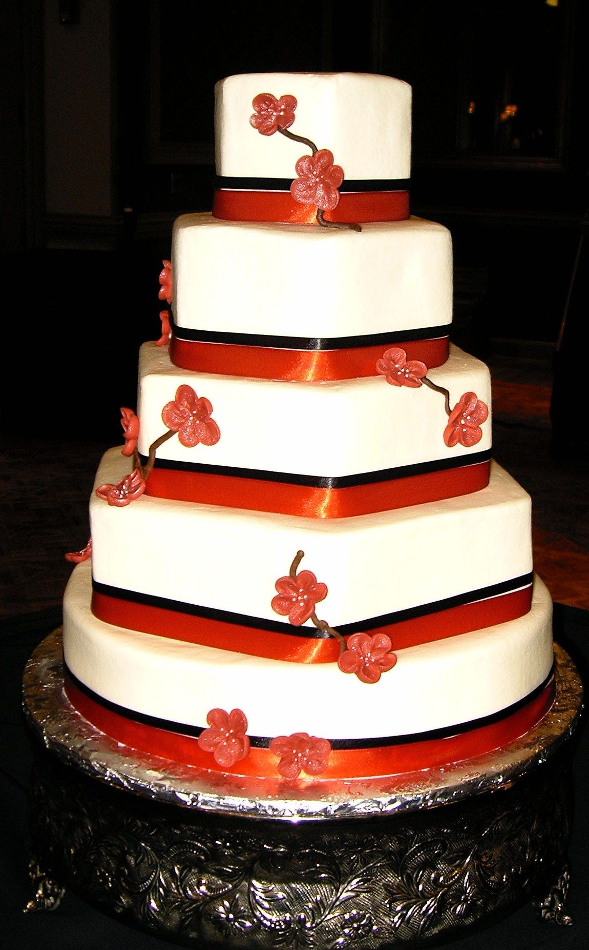 Buttercream iced wedding cake with royal icing flowers