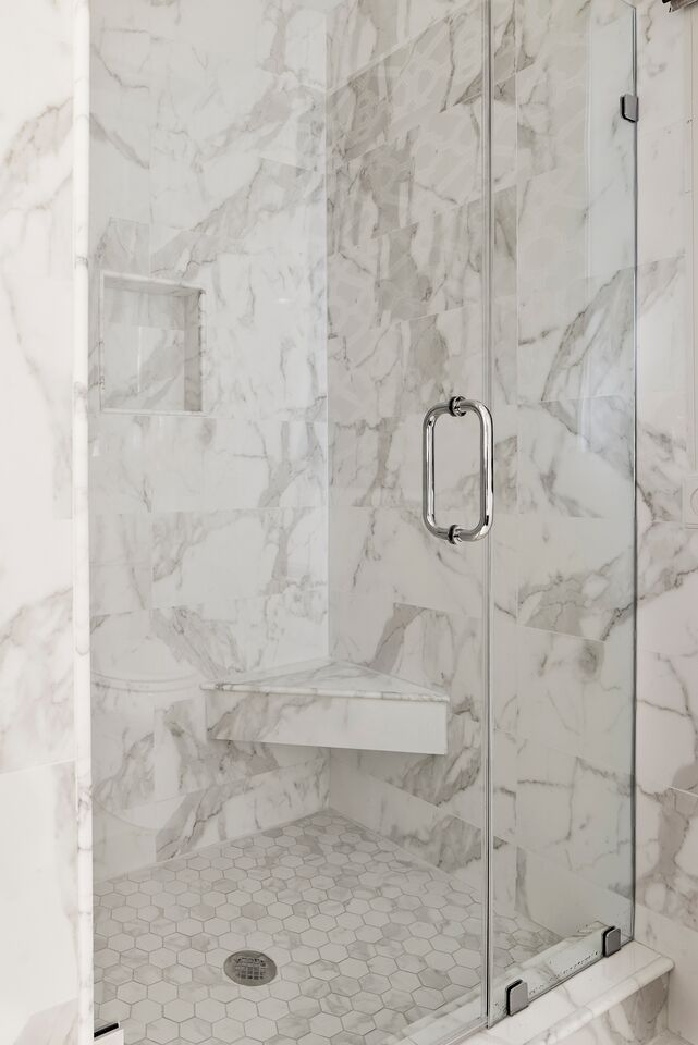 This Walk In Shower In The Master Bath Features Glazed Porcelain Tile 10 X 24 Large Format Size For The Wall Shower Tile Tile Bathroom Porcelain Tile Bathroom