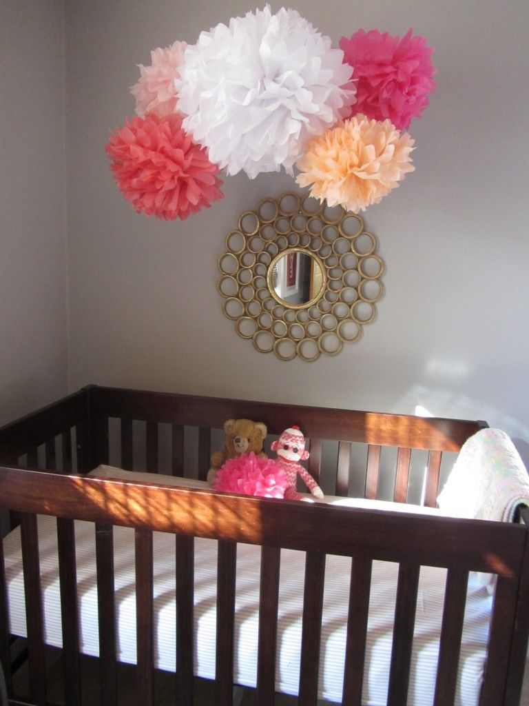 Love the use of pom-poms over the crib - it acts as a baby mobile and provides a great pop of color! #nursery